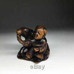 Antique Japanese fine carved wood Netsuke of a Karako And Goat, 19th c Meiji Edo